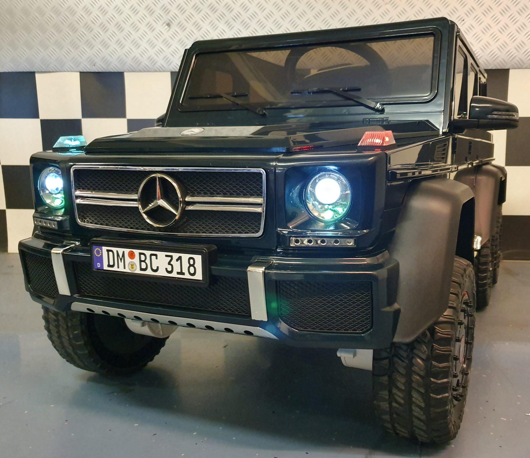 Elektrische kinderauto Mercedes G63 6×6  met MP4 en 2.4G RC 12V groen 1 pers