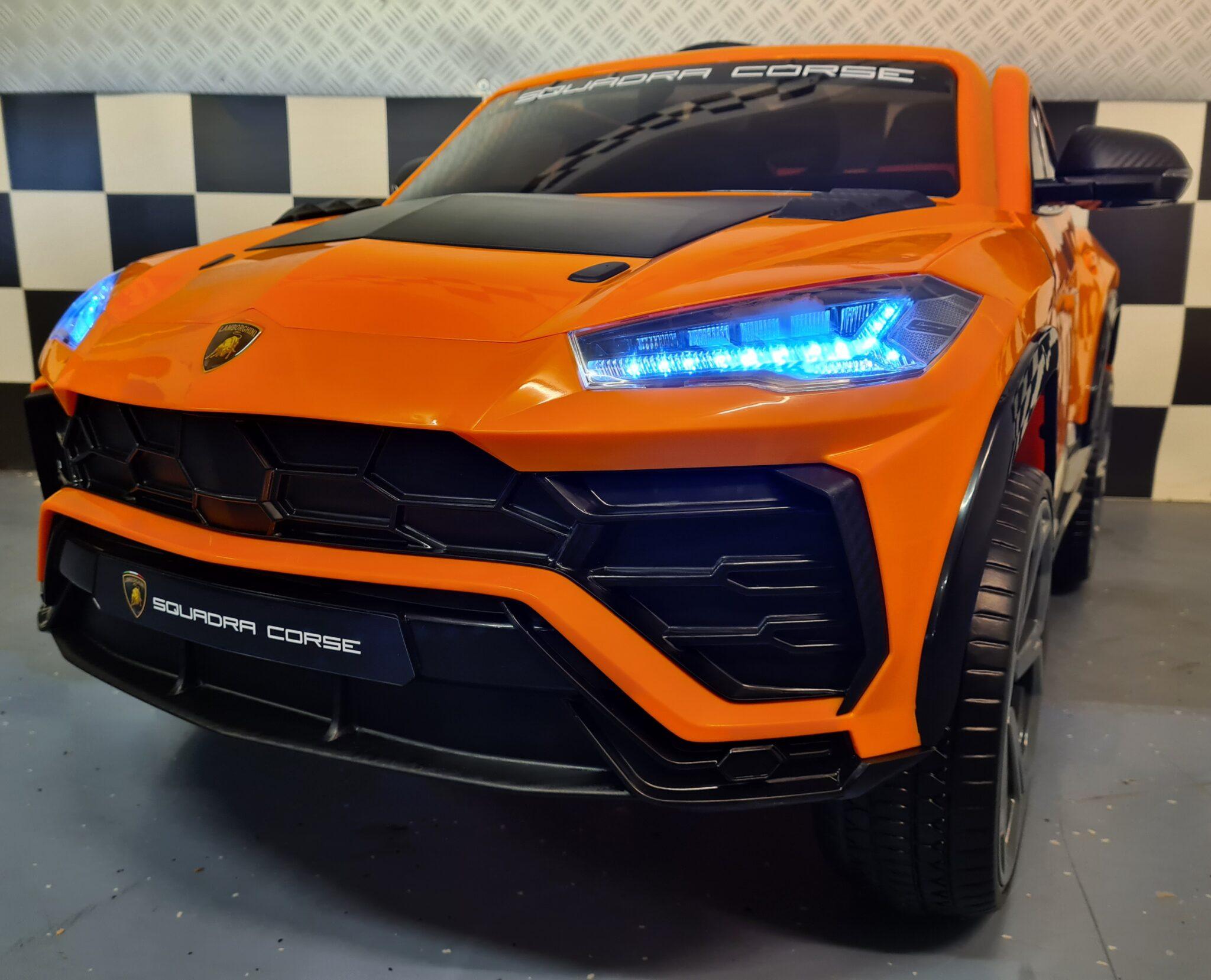 Elektrische kinderauto Lamborghini Urus oranje met soft start