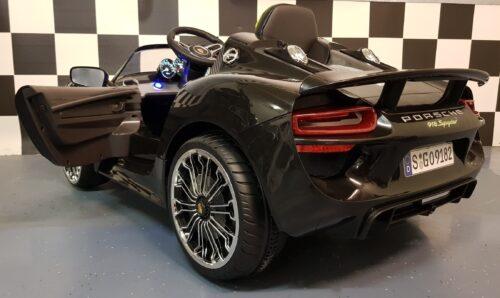 Kinderauto Porsche Spyder zwart 12 volt accu 2.4G RC bediening